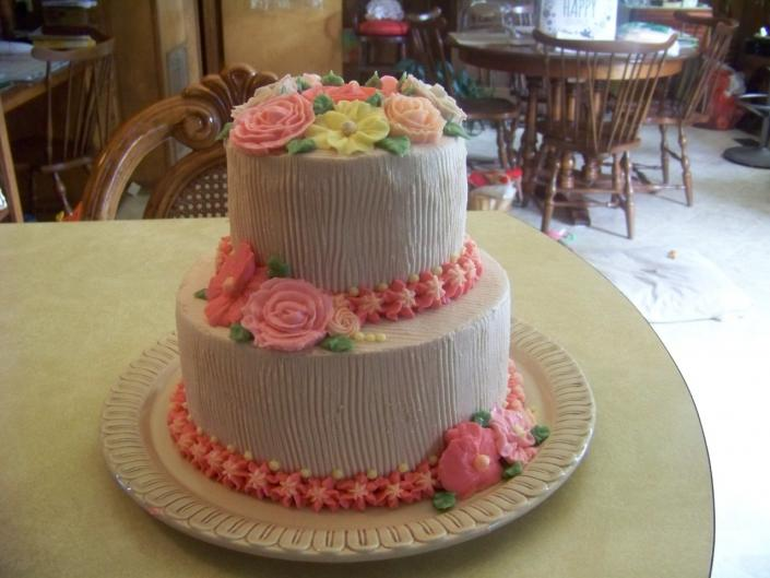 [Image: A beautiful summer flowers cake... white almond cake with buttercream icing]