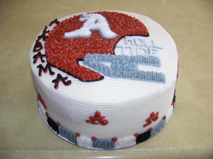 This Alabama cake with helmet design.It was made with almond wedding cake and buttercream icing that matches the Alabama colors.