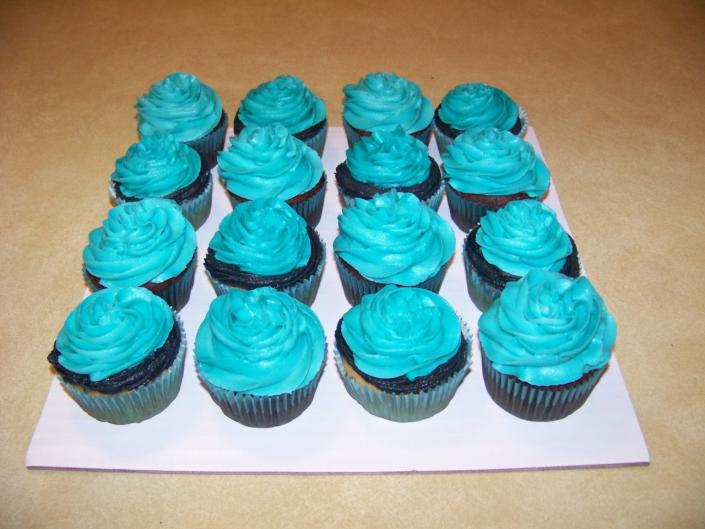 These cupcakes went with a small 16th Birthday cake.The colors of teal and black with white cake.