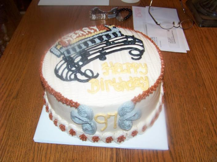 [Image: this 97th year old loves his harmonica. So I made that the design of the cake. White cake with buttercream.]