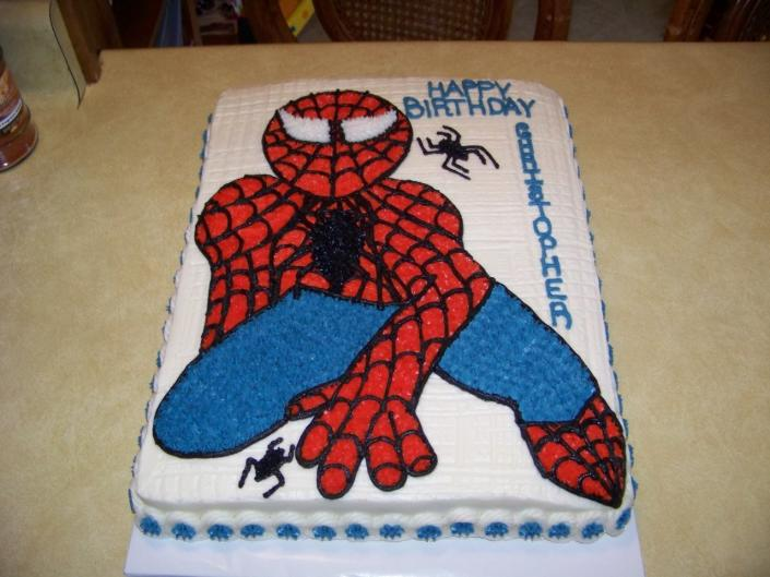 [Image: This young boy loves Spider man. So with white cake and buttercream with the design of spider man.]