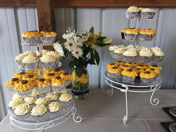 [Image: Cupcakes with light cream rose and a golden sunflower]